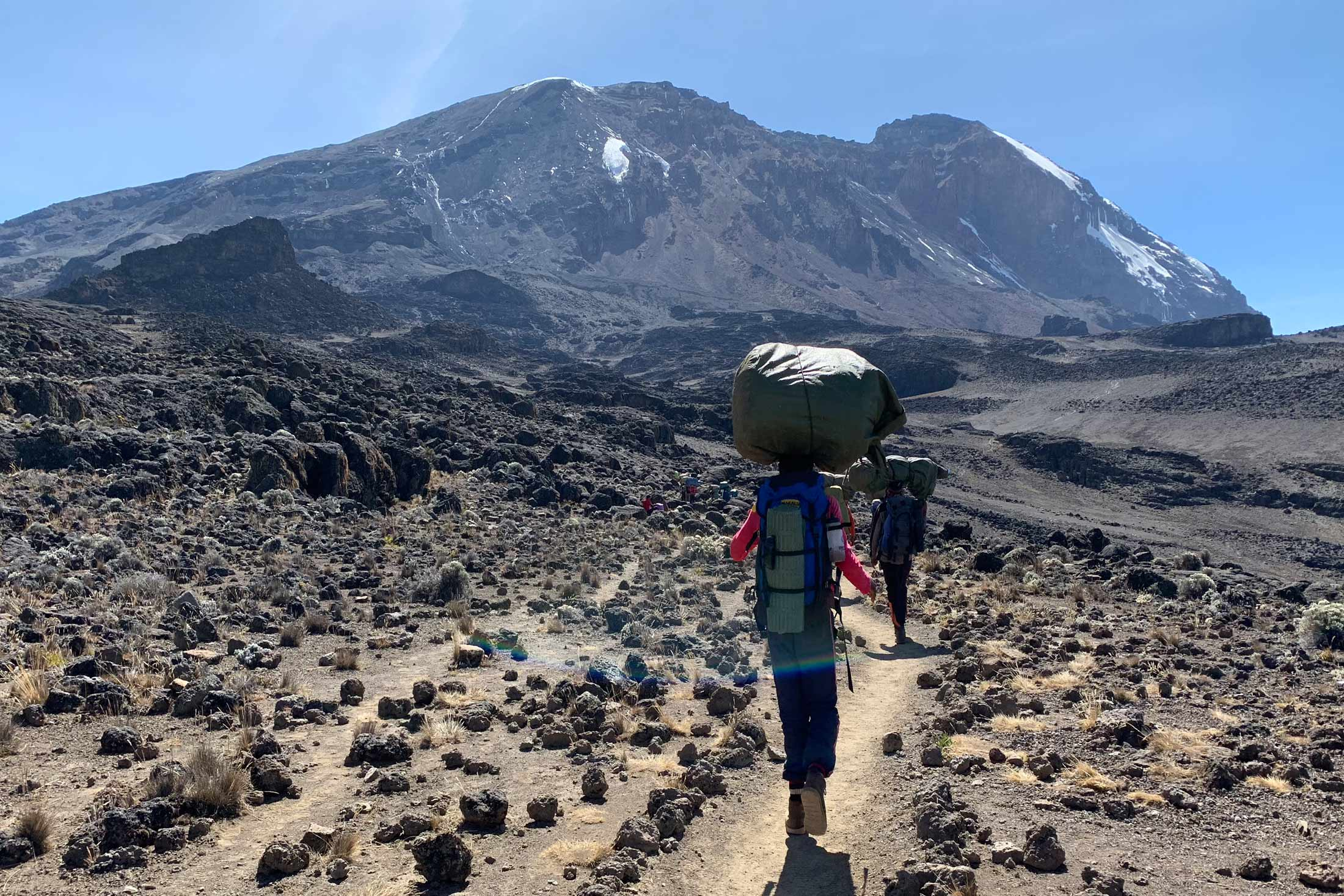 John Mina with Mount Kilimanjaro